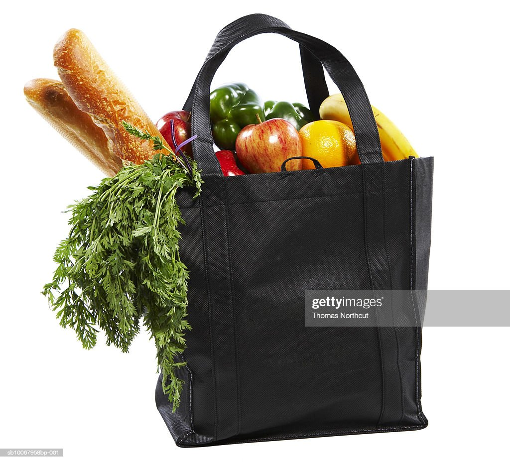 Bag of groceries on white background : Stock Photo