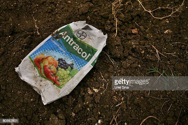 A bag of insecticide lays in a cotton field on April 2008 in the village of Sunna in the Vidarbha region of Maharashtra state India A wave of...