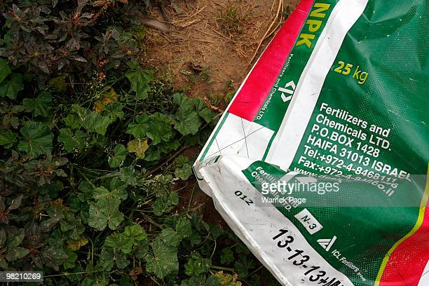 A bag of Israelimade fertilizer smuggled from Egypt is seen on Palestinian farm on March 27 2010 in Beit Lahiya Gaza Strip Farmers throughout Gaza...
