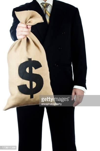 Bag of money held by businessman