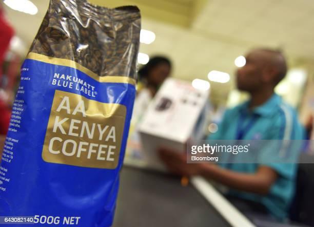 A bag of Nakumatt blue label AA kenya coffee sits on a conveyor belt at the checkout area inside a Nakumatt Holdings Ltd supermarket in Nairobi Kenya...