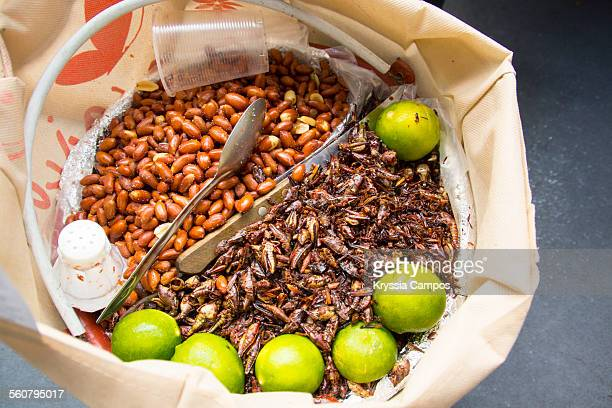 Bag of peanuts and grasshoppers for sale