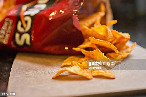 A bag of PepsiCo Inc Doritos brand snack chips is arranged for a photograph in Tiskilwa Illinois US on Wednesday Sept 28 2016 PepsiCo Inc is...
