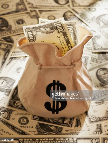 Bag of US Dollars on pile of US Dollars