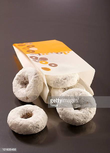 Bag of white powdered donuts