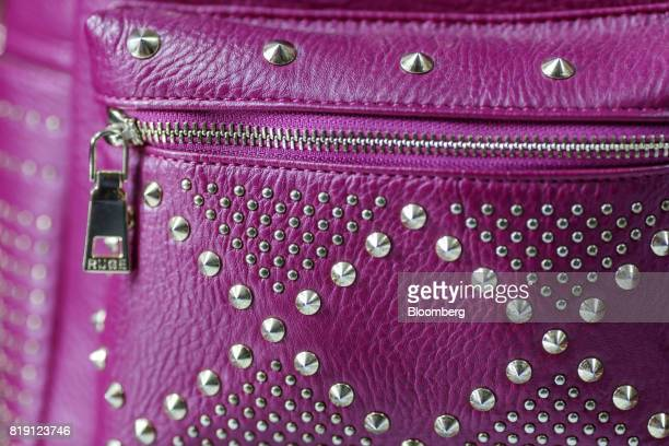 A bag sits on display at the Shakra Leather Arts store in the Dharavi area of Mumbai India on Tuesday July 18 2017 India's new goods and services tax...