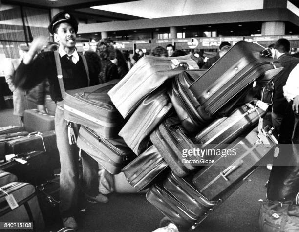 A baggage handler makes his way through the Eastern Air Lines terminal crowded with passengers at Logan Airport in Boston circa February 1988