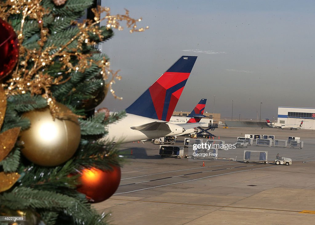 Baggage handlers load and unload Delta planes at the Salt Lake City international Airport on November 27, 2013 in Salt Lake City, Utah. A wintry storm system that is covering much of the nation is threatening to wreak havoc on holiday travel .