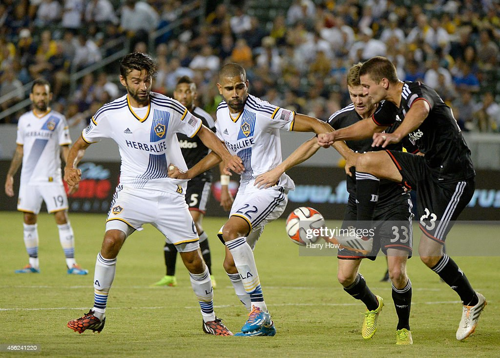 Baggio Husidic #6 and Leonardo #22 of the Los Angeles Galaxy battle for a ball with Taylor Kemp #33 and <a gi-track='captionPersonalityLinkClicked' href=/galleries/search?phrase=Perry+Kitchen&family=editorial&specificpeople=5005041 ng-click='$event.stopPropagation()'>Perry Kitchen</a> #23 of D.C. United during the second half at StubHub Center on August 27, 2014 in Los Angeles, California.