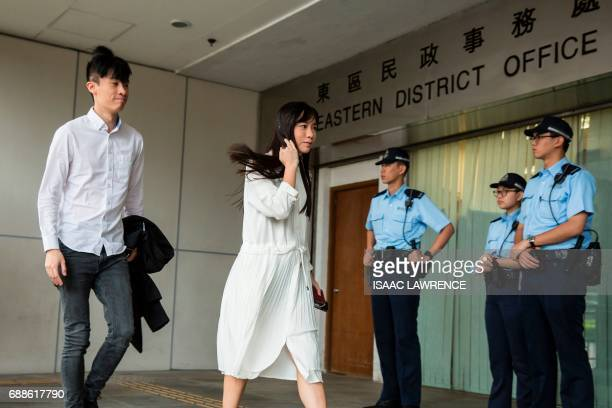Baggio Leung and Yau Waiching from localist political group Youngspiration arrive at court in Hong Kong on May 26 to plead not guilty to taking part...