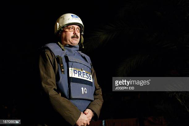 AFP Baghdad deputy bureau chief Assaad Abboud conducts a live interview with France 24 television from the Iraqi capital 06 December 2006 The...