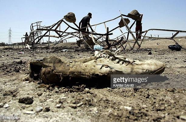A shoe that once belonged to a victim of a bombing at a soccer field is seen at the site in Baghdad 03 August 2006 A total of 16 people died late...