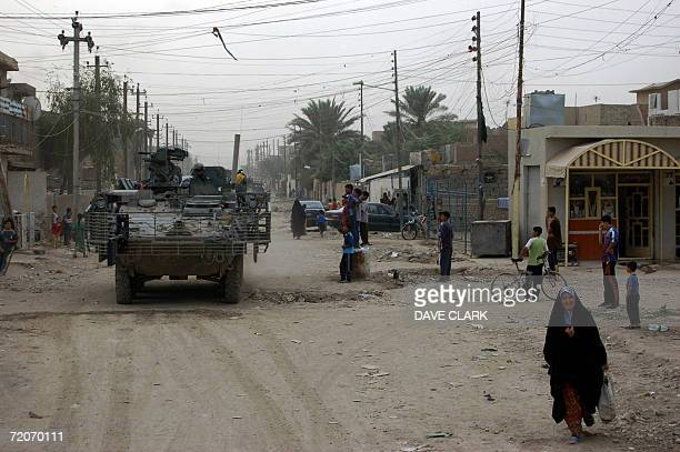 A US Army stryker armoured vehicle patrols a residential street in Obeidi eastern Baghdad 02 October 2006 US forces are scouting districts of eastern...