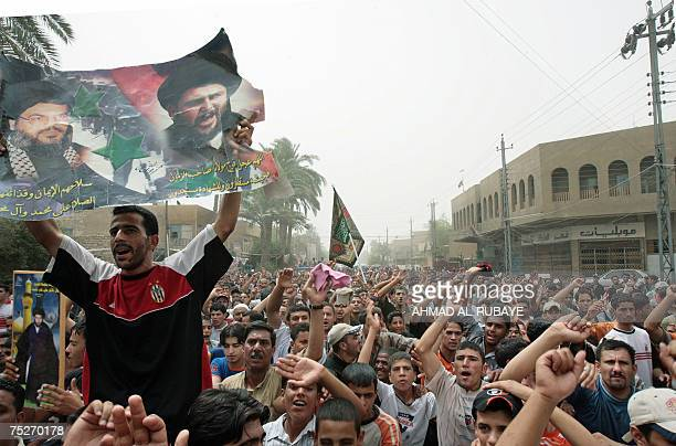 An Iraqi Shiite carries a combo picture for Shiite firebrand cleric Moqtada alSadr and Lebanese Hezbollah leader Hassan Nasrallah as he takes part in...