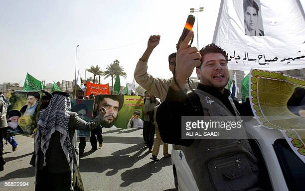 An Iraqi Shiite protester from alDawa party brandishes a gun as he takes part in a demonstration 11 February 2006 in central Baghdad over the...