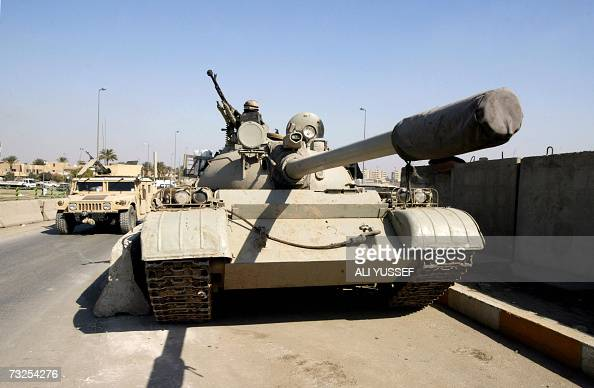 An Iraqi soldier sits on top of his armoured tank as he mans a checkpoint in eastern Baghdad 08 February 2007 At least 21 people were killed today...