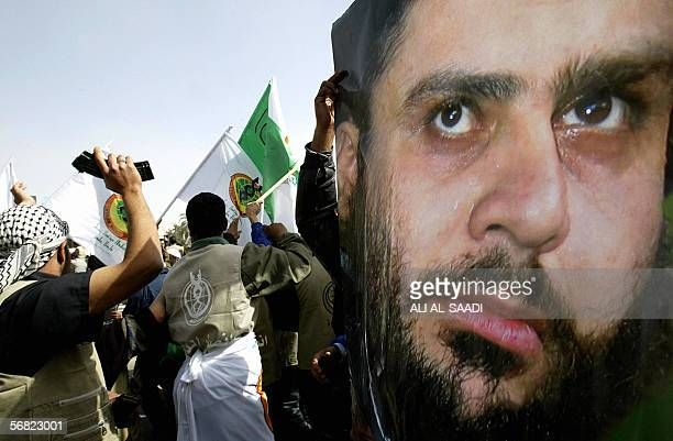 Iraqi Shiite protesters from alDawa party show show a huge picture of firebrand cleric Moqtada Sadr during a demonstration 11 February 2006 in...