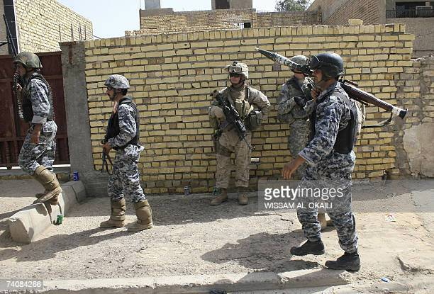 Iraqi special forces and US soldiers patrol the Baghdad Shiite stronghold of Sadr City 06 May 2007 Iraqi police as well as local eye witnesses...