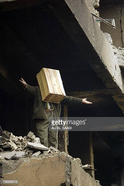 Iraqi theatre actor and teacher at Baghdad's Fine Arts Academy Jabbar Mohaybes performs a play in the ruins of Baghdad's alMutanabi street 08 March...