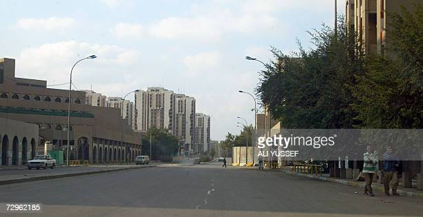 Iraqis walk on Baghdad's deserted Haifa street 10 January 2007 Iraqi troops sealed off today the notorious stronghold of Sunni insurgents in central...