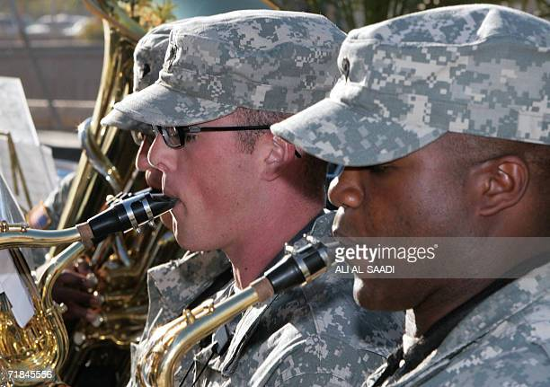 Musicians in a military band play musical instruments at Victory Camp in the airport grounds in Baghdad 11 September 2006 during a commemoration of...