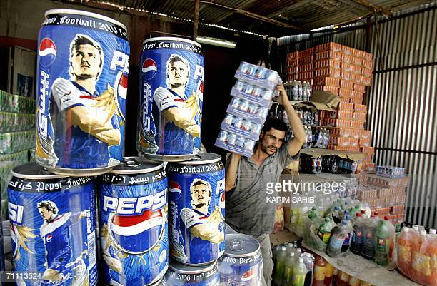 Pepsi cans showing the image of football player David Beckham are displayed at a a kiosk in Baghdad 03 June 2006 With less than a week for the start...