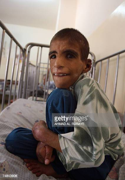 Saddam a fifteenyearold orphan sits inside his bed after he was transferred to 'Dar alHanan' orphanage for girls 21 June 2007 Saddam was discovered...