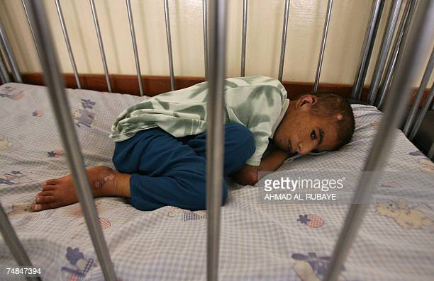 Saddam a fifteenyearold orphan sleeps inside his bed after he was transferred to 'Dar alHanan' orphanage for girls 21 June 2007 Saddam was discovered...