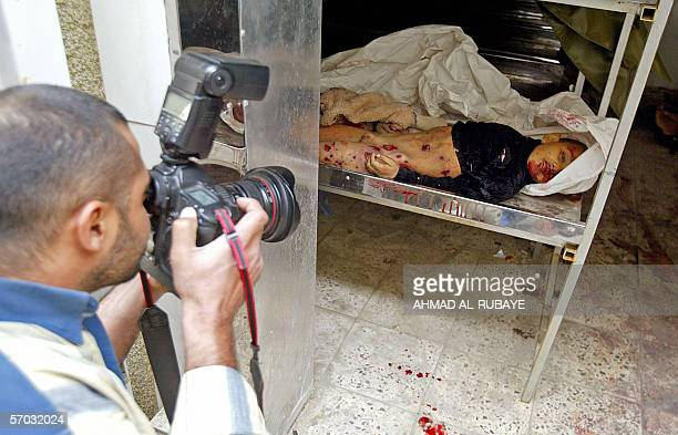 The body of an Iraqi school boy lay inside the morgue of a local hospital in Baghdad 09 March 2006 The boy is one of six people who were killed in a...
