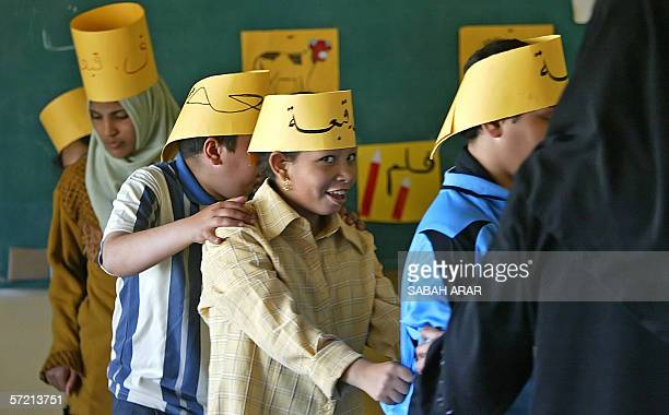 TO GO WITH AFP STORY IRAQUNRESTCHILDREN Iraqi children traumatized by their country's conflict dance at a classroom at alRajaa Institute for Special...