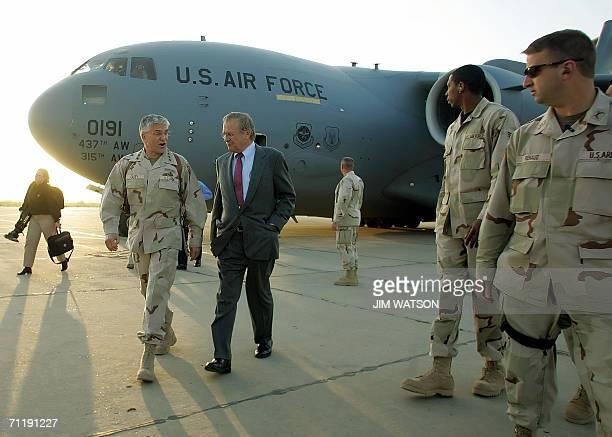 US Defense Secretary Donal Rumsfeld speaks with US Army General George Casey upon arriving at Baghgad International Airport 26 April 2006 Rumsfeld is...