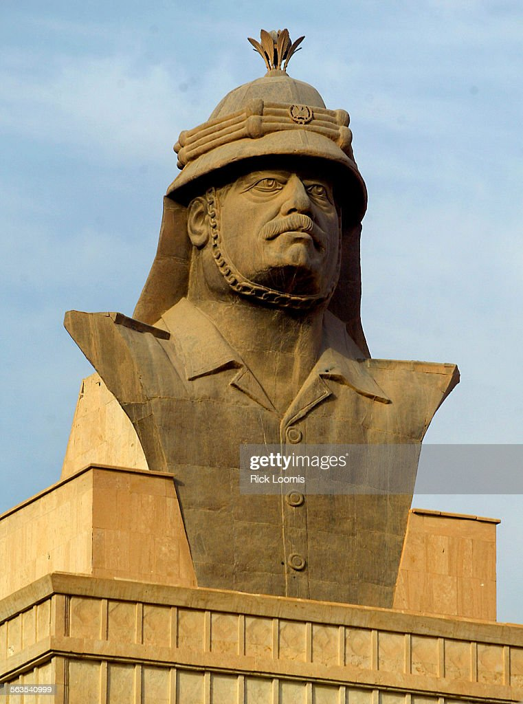 Baghdad Iraq––One of four busts of Saddam Hussein that adorn the roof of his former presidential palace on the Tigris River in Baghdad Iraq Photo/Art...