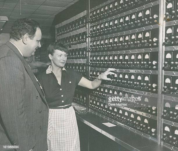 JUN 15 1950 Bagno and Mrs Jackson examine the main switchboard in the office of the Denver Burglar Alarm company 422 Twentyfirst street All alarms...