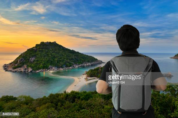 Bagpacker travel the beautyful place Krabi island with the traveler see the view of island in Thailand, Asia. Traveling concept.