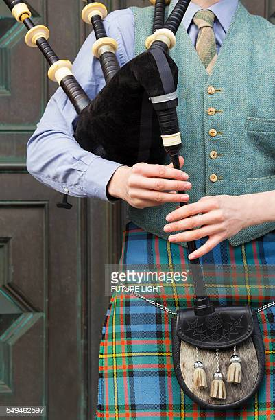 Bagpipe player in kilt