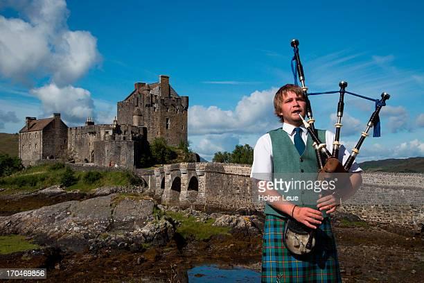 Bagpiper at Eilean Donan Castle at Loch Duich