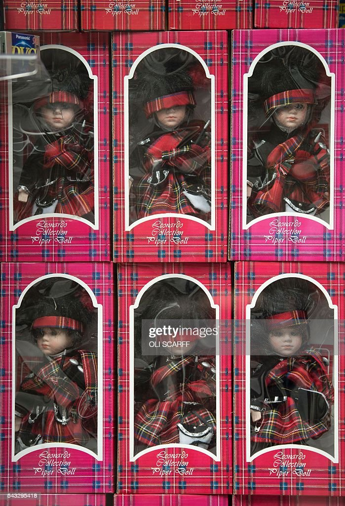 Bagpiper dolls are displayed for sale in a gift shop in the city centre of Edinburgh, Scotland on June 27, 2016. Britain's historic decision to leave the 28-nation bloc has sent shockwaves through the political and economic fabric of the nation. It has also fuelled fears of a break-up of the United Kingdom with Scotland eyeing a new independence poll, and created turmoil in the opposition Labour party where leader Jeremy Corbyn is battling an all-out revolt. SCARFF