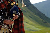 I found a bagpiper somewhere in Scotland, in a deserted spot.