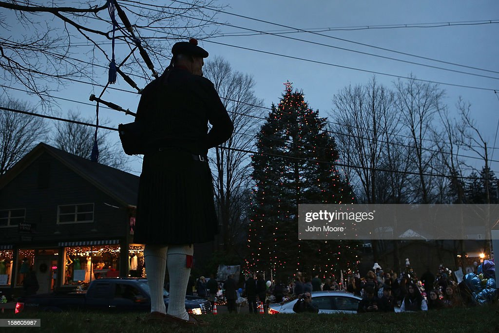 A bagpiper plays 'Danny Boy' at a streetside memorial on December 20, 2012 in Newtown, Connecticut. Six services were held Thursday in the Newtown area for students and teachers killed in last Friday's attack that killed 26 people at Sandy Hook Elementary School.