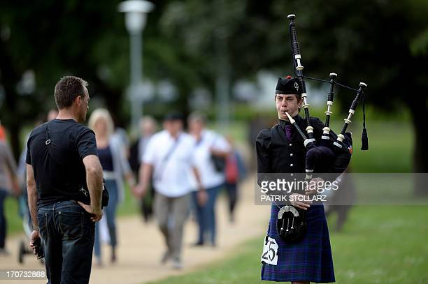 A bagpiper plays his instrument during the BagOpen International Pipeband Competition of the Scottish Festival in Xanten western Germany on 16 June...