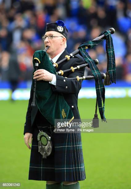 A bagpiper plays in memory of former Everton player Alex Young before the Premier League match at Goodison Park Liverpool