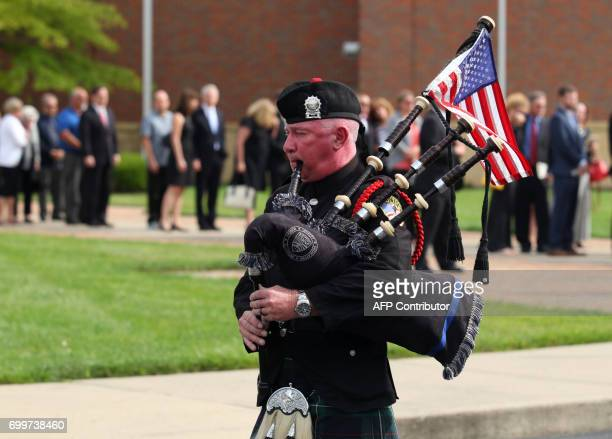 A bagpiper plays outside of Wyoming High School in Wyoming Ohio on June 22 following the funeral for Otto Warmbier Warmbier an American university...