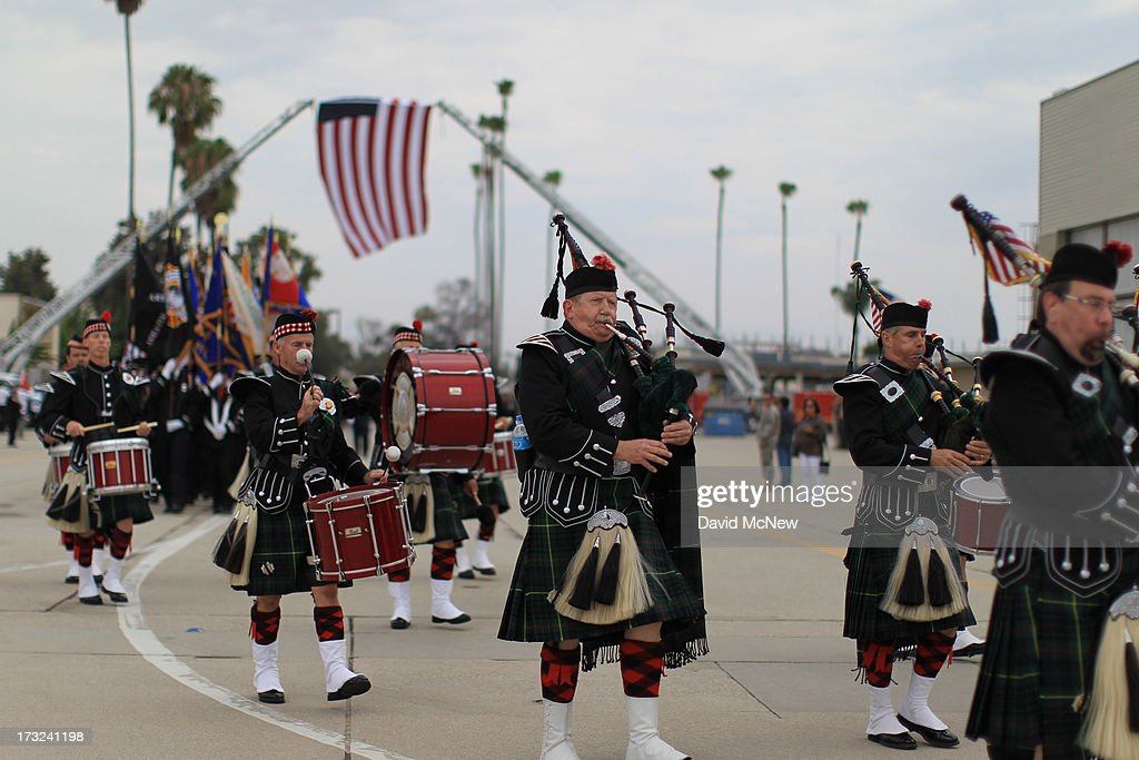 Bagpipers arrive for the arrival of two of the nineteen firefighters killed fighting the Yarnell Fire in Arizona arrive to the Joint Forces Training Base, Los Alamitos Air Field on July 10, 2013 in Los Alamitos, California. The memorial ramp ceremony, coordinated in part by the California Fire Foundations Last Alarm Service Team, honors Granite Mountain Interagency Hotshot Crew members 21-year-old Kevin Woyjeck and 20-year-old Christopher MacKenzie.