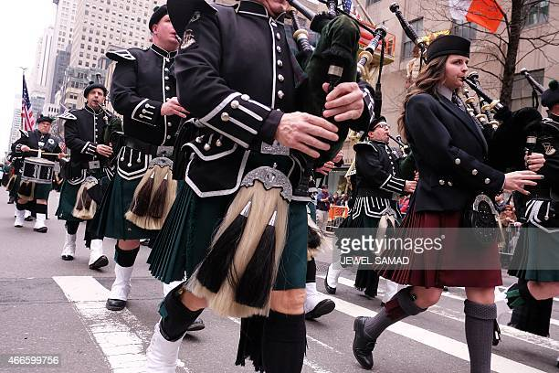 Bagpipers play as they march during the St Patrick's Day parade in New York on March 17 2015 AFP PHOTO/JEWEL SAMAD