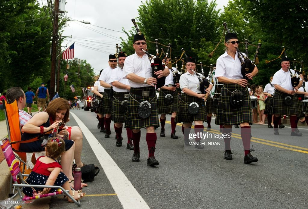 Bagpipers play during the Independence Day parade in Takoma Park Maryland on July 4 2013 Independence Day celebrates the declaration of independence...