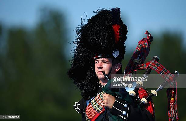 Bagpipes are played after the Men's Triathlon at Strathclyde Country Park during day one of the Glasgow 2014 Commonwealth Games on July 24 2014 in...