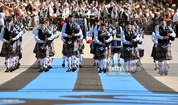Bagpipes musicians perform on August 7 2011 in Lorient during the celtics nations Great Parade of the 'festival interceltique de Lorient' It is the...