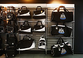 Bags are displayed at the shop prior to the Barclays Premier League match between Newcastle United and Arsenal at St James' Park on August 29 2015 in...