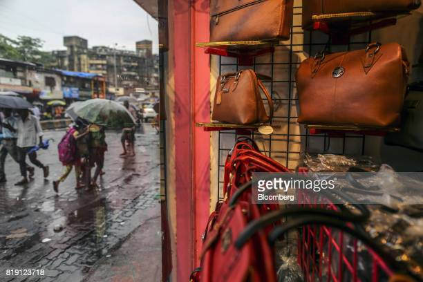 Bags are displayed in the window of a leather goods store in the Dharavi area of Mumbai India on Tuesday July 18 2017 India's new goods and services...