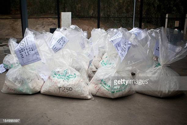 Bags filled with cocaine to be burned by workers of the Peruvian Ministry of Interior are seen at a police facility in Ate in outskirts of Lima on...